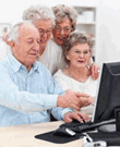 Older adults sitting in front of a computer screen